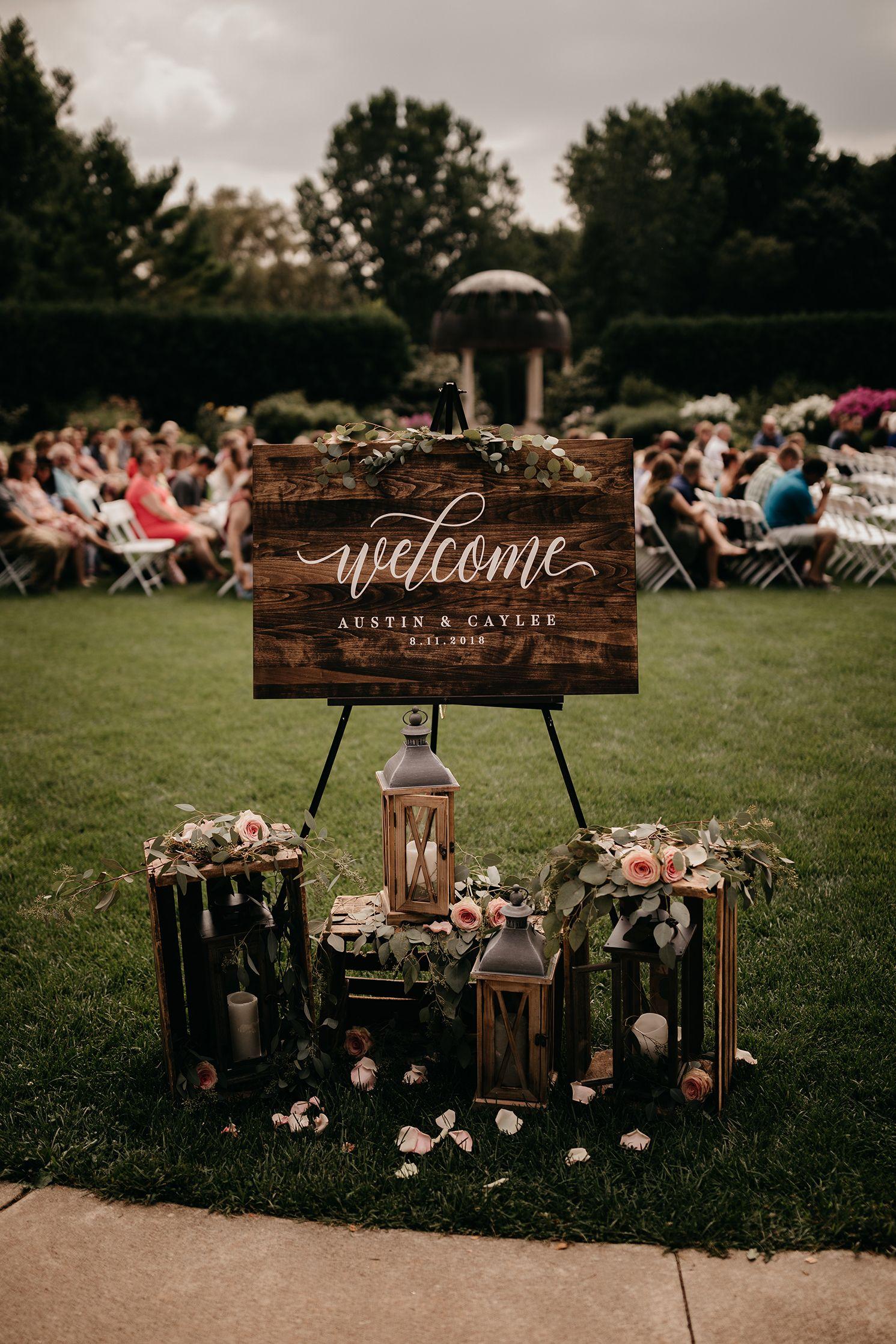 WOOD CALLIGRAPHY WELCOME SIGN ROMANTIC AND MOODY WISCONSIN BOTANICAL GARDEN WEDDING   CAYLEE + AUSTIN via Wedding Planner & Guide #weddingwelcomesign