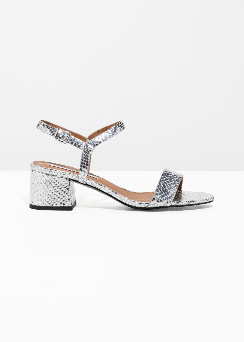 24810f54ef5 Front image of Stories mid heel sandals in silver
