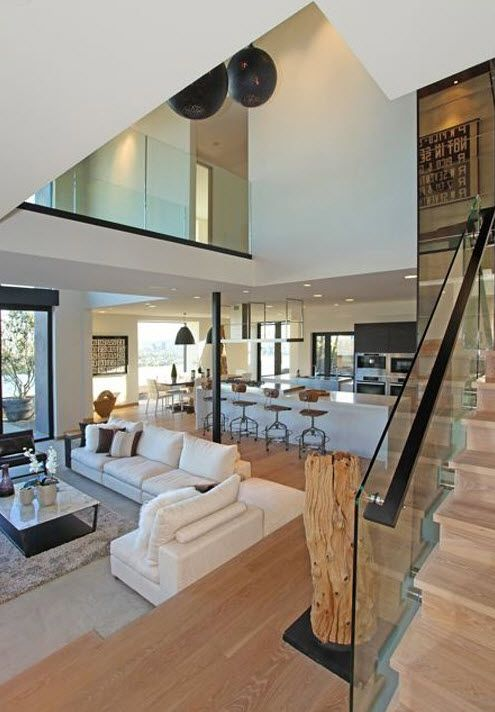 Wonderful open floorplan and glass stairs also love the fireplace wall etc my new home ideas in pinterest rh br