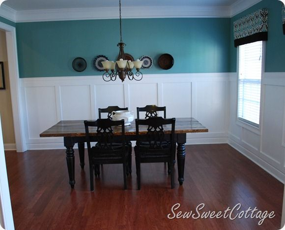 Board and Batten Dining room with aqua walls  color on walls is BEHR Mermaid. Board and Batten Dining room with aqua walls  color on walls is