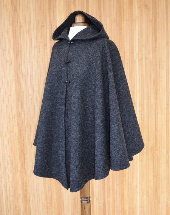 b8c3327dfb5c3 A handmade hooded cape for women, made from boiled wool fabric in dark  grey. Fastened with three toggle buttons, this cape combines elegance with
