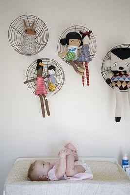 dolls sitting in wire baskets