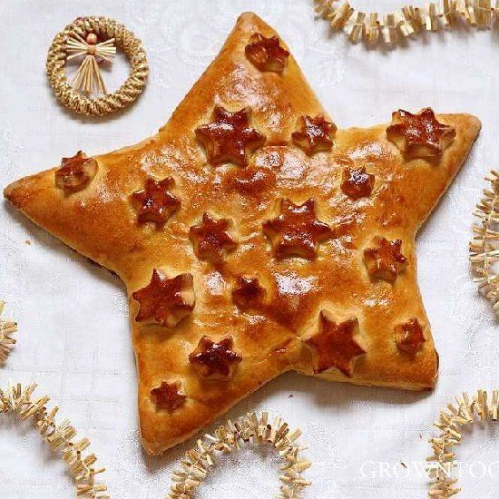 Christmas Star Bread from enriched dough filled with a naturally sweet hazelnut-raisin filling with cinnamon and orange zest
