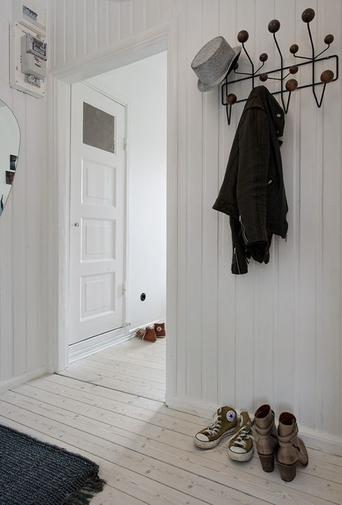 Love this hallway Pale wood floors and white wood.
