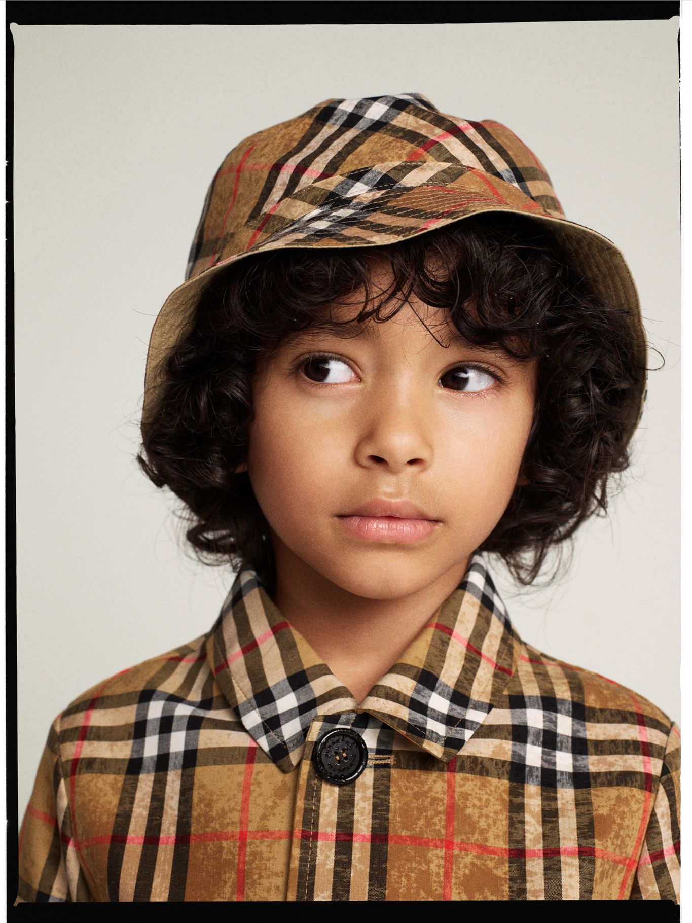 A cotton bucket hat by Burberry in  Vintagecheck – a print first used in  the 1960s. The design is lined in gabardine to protect against sun and  showers. f341db296a2