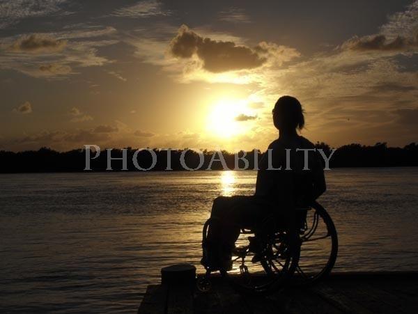 Photographer Jacob Rhoades wheelchair;woman;female;beach;ocean;water;sunset