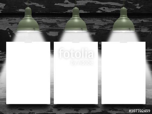 Close-up of three blank frames hanged by clips against dark scratched wooden background