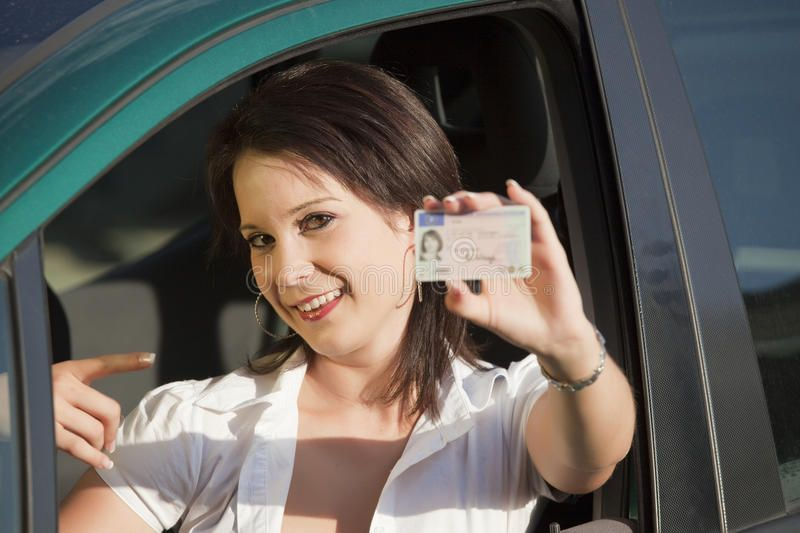 Female With Driving License Young Female Showing Her Driving