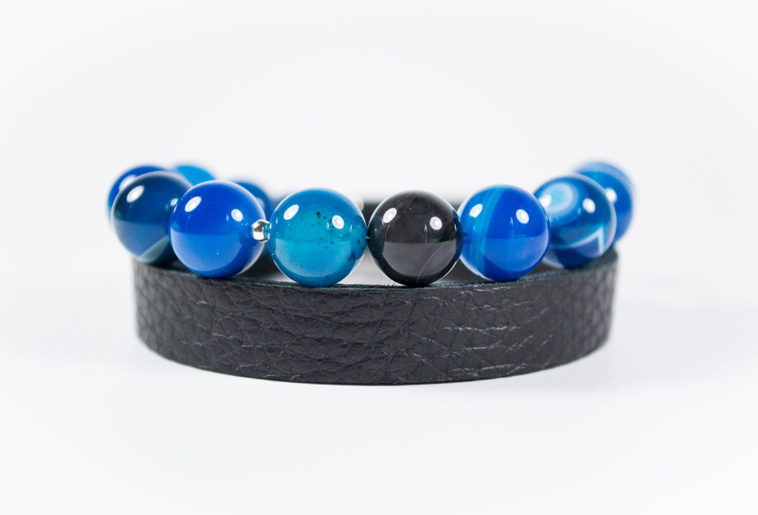 A personal favourite from my Etsy shop https://www.etsy.com/listing/468033403/blue-jade-beads-and-real-leather