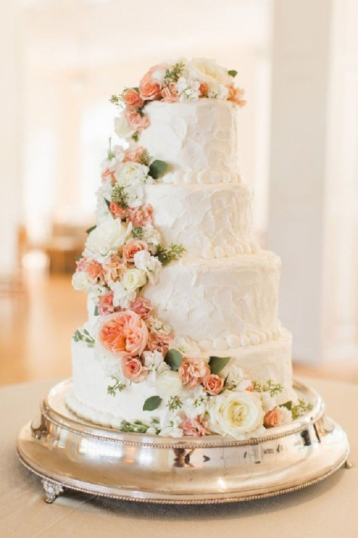 Four Tier Wedding Cake With Peach And White Cascading Flowers