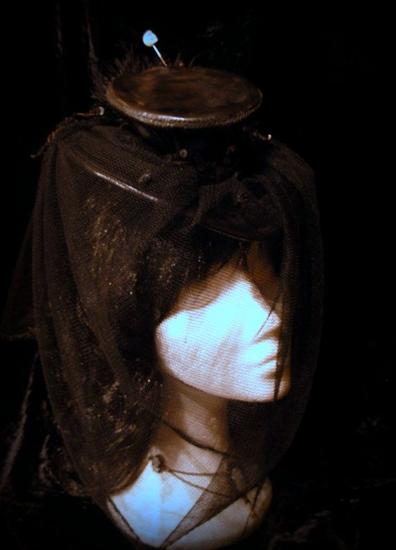 Distressed black leather mourning mini top hat.  Steampunk. Victorian. Goth. Shabby.. €55.00, via Etsy.