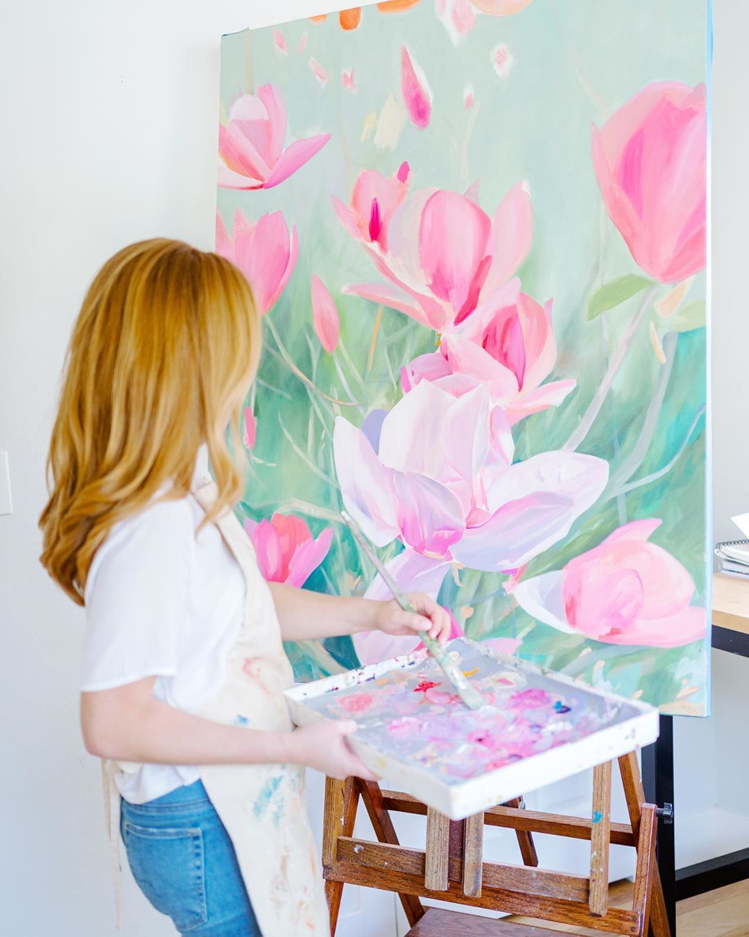 Take a look at artist, CoCo Zentner, in her Texas home studio and a little behind the scenes on her current work-in-progress. She loves painting florals (in pink) with oil paint. Learn more about the artist through the link! #artist #inthestudio #oilpainting #painting #studio #art #artforsale
