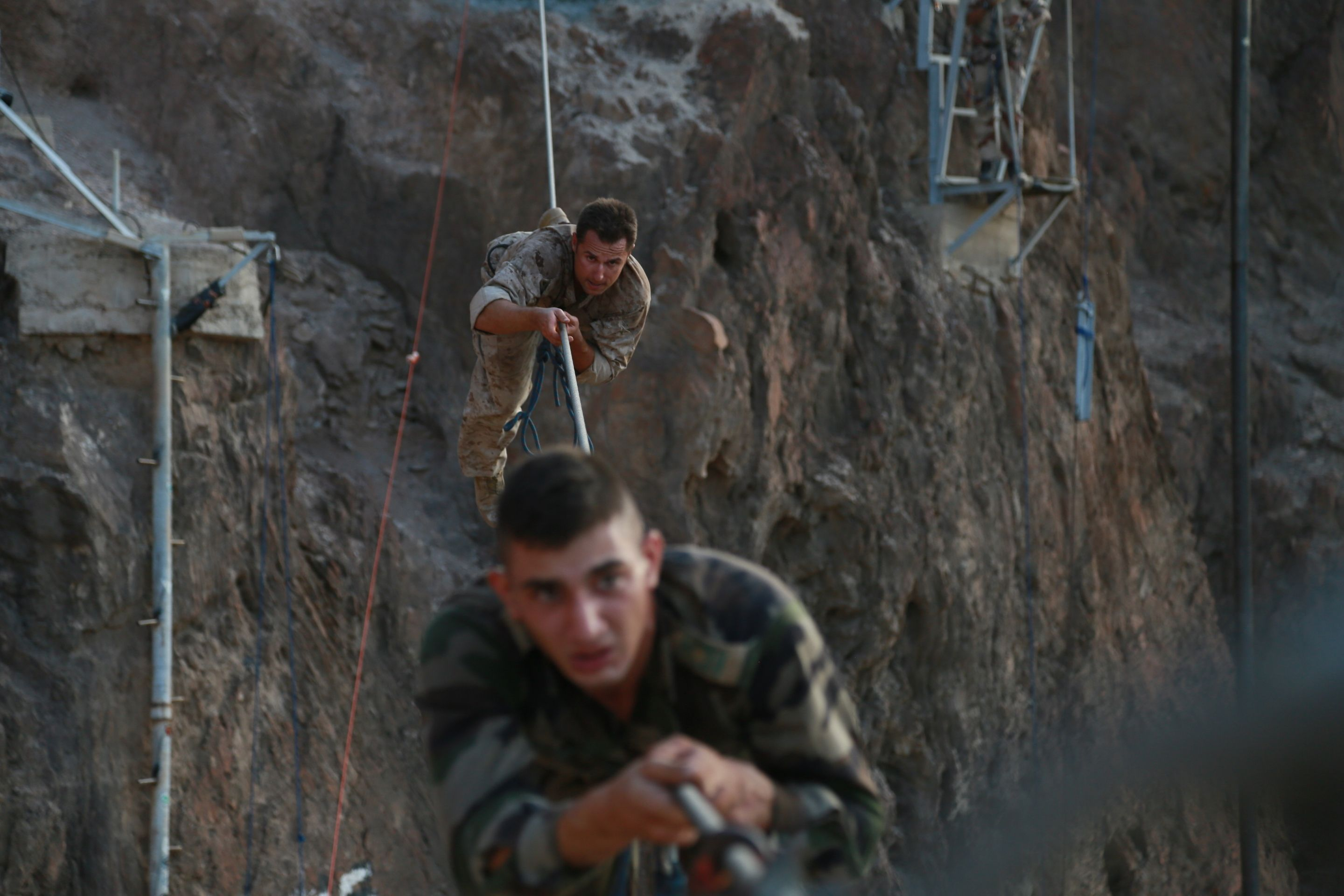 US Navy corpsman and French Army soldier go through a high cable ...