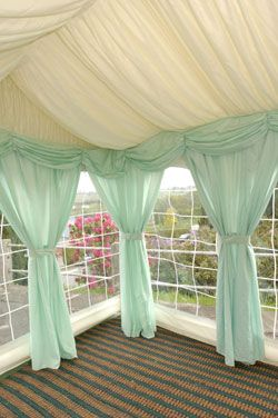 Mint Drapes For A Pop Of Color In Your Wedding Tent