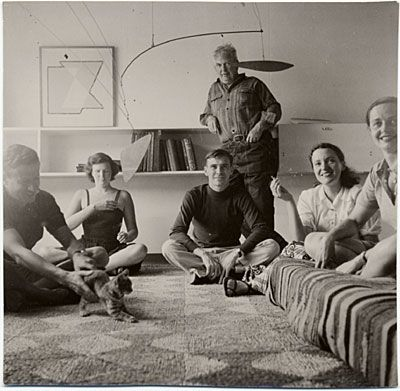 Photograph of the New Canaan House I, New Canaan, Conn., ca. 1947. Present, l. to r. are an unidentified man (holding a kitten), Joan McVitty, Ed Barnes, Alexander Calder, Constance Breuer, and Mary Barnes.  Designed by Marcel Breuer.
