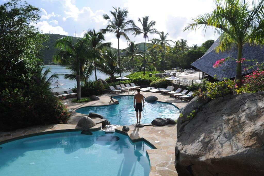Pool after pool set against the sparkling blue Atlantic Ocean in the British Virgin Islands. Rosewood Little Dix Bay Resort.