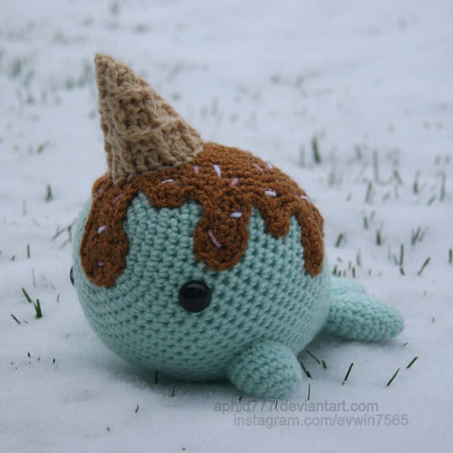 adorable and with sprinkles crochet narwhal with ice cream on his