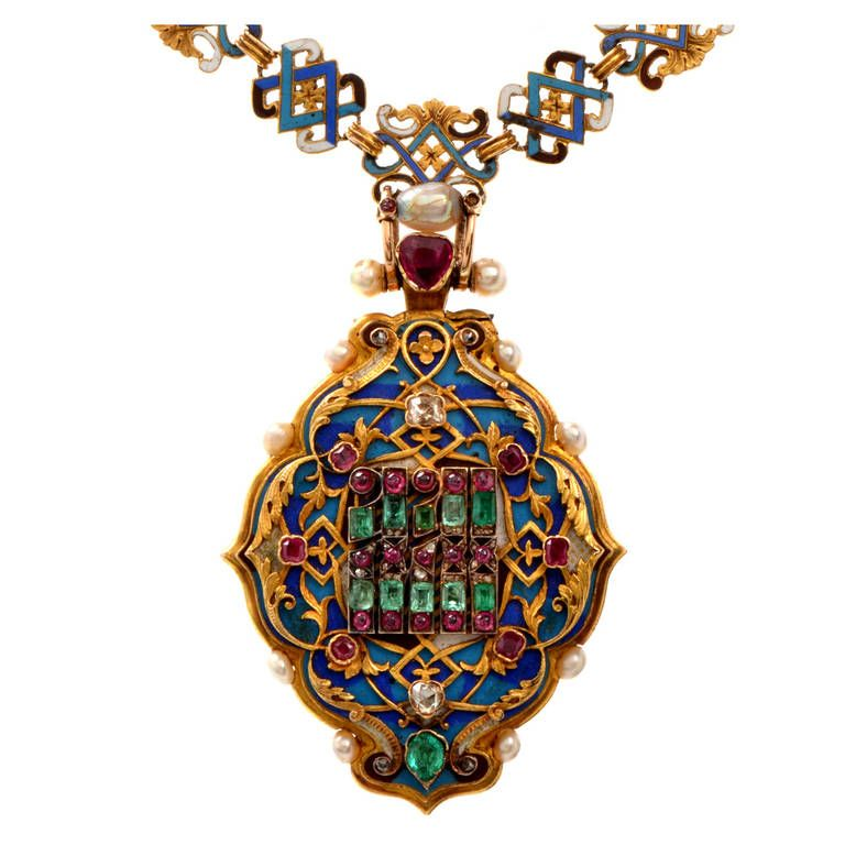 Rare Victorian Holbeinesque Gem Set Enamel Gold Pendant Locket Necklace. This rare antique Victorian necklace with a highly ornate locket pendant is of European provenance, crafted in solid 18K yellow gold. Inspired by the 1870's Halbeinesque style (The German designer Hans Halbein who created the most valuable locket pendants for royal families in Europe) this immaculately decorated pendant exhibits artistic gold relief profiles of naturalistic design on an artfully enameled surface. UK, c…