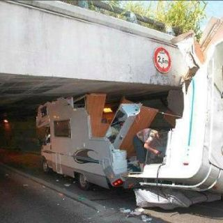 A 3 meter vehicle under a 2.6 meter bridge