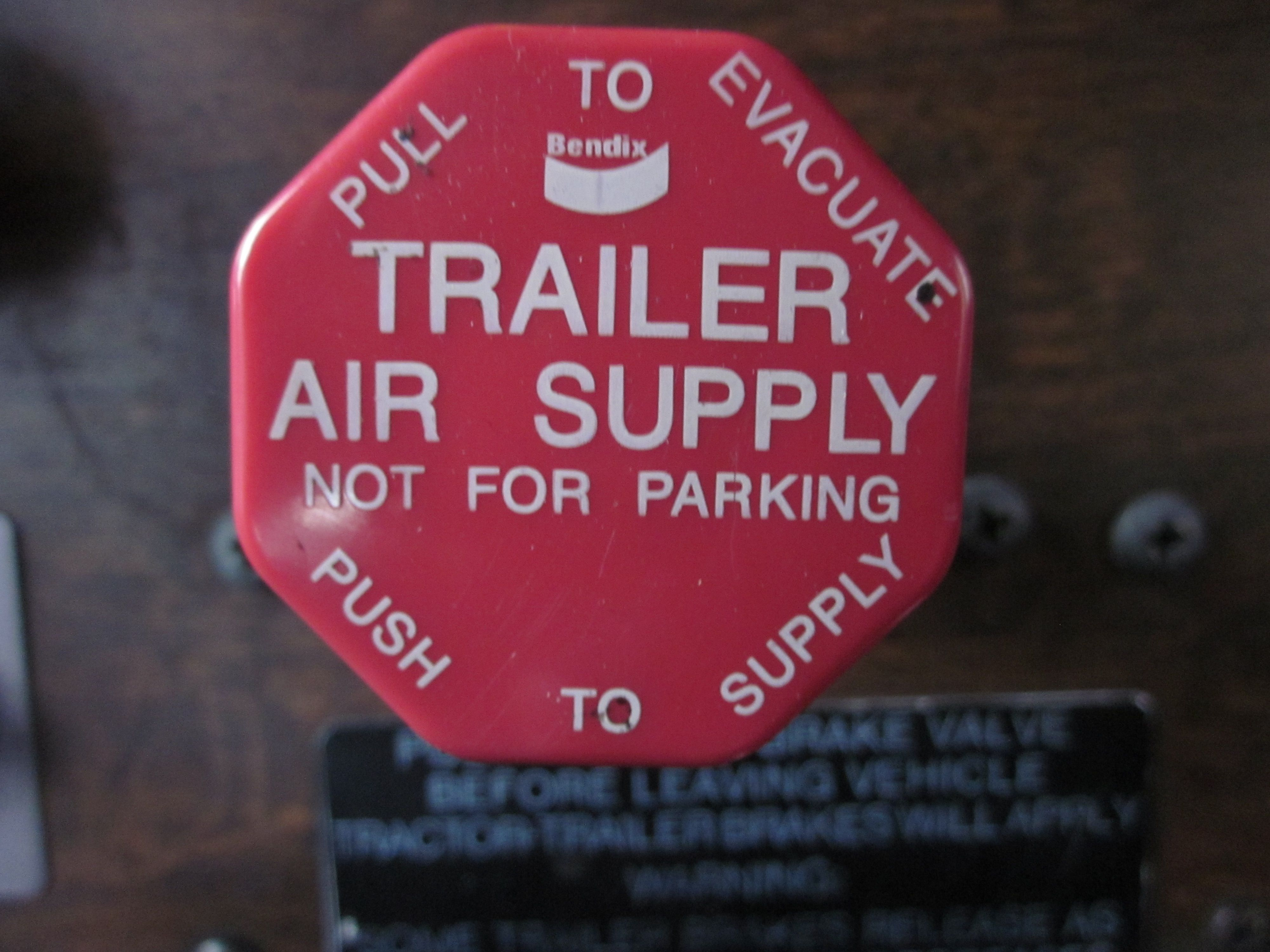 Trailer Air Supply push to release trailer brakes and