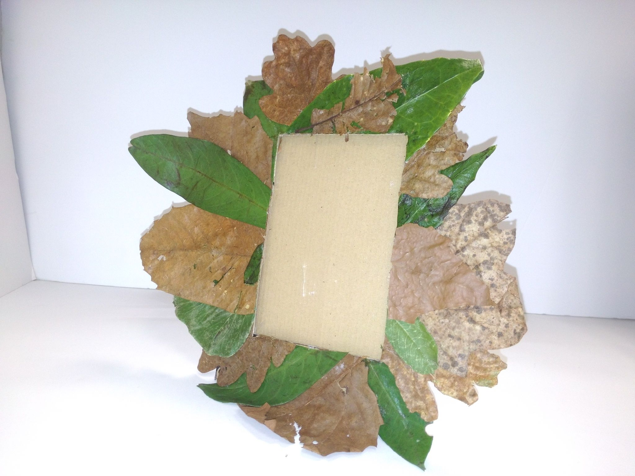 a photo frame made out recycled materials | my portfolio 14-15 ...