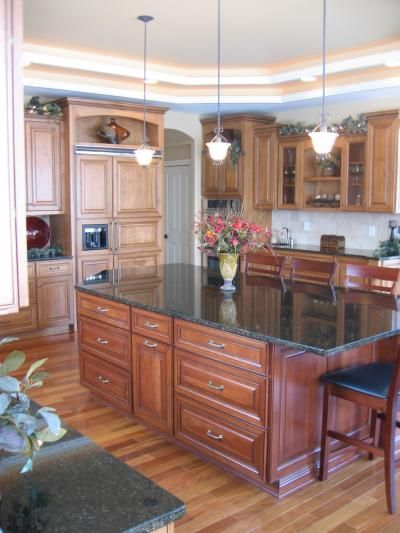 Pioneer Cabinetry Melbourne Door Style In Both Maple And Cherry Wood Kitchen Design Cabinetry Cabinet Design