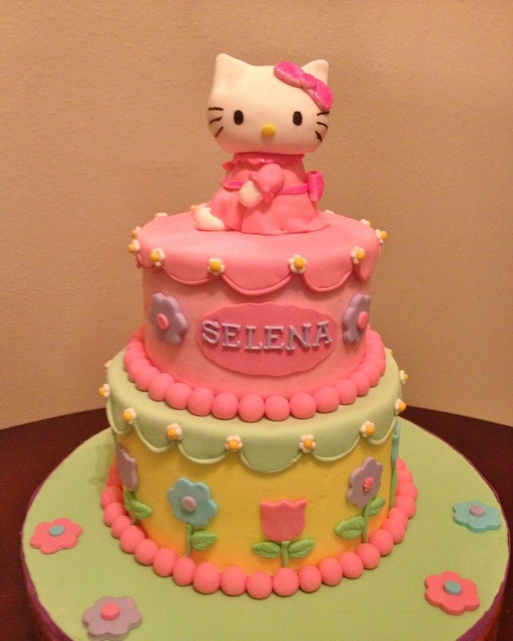 Gumpaste Hello Kitty on top of 6 8 cakes Buttercream finish w