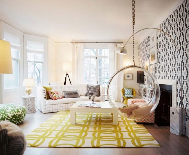 fun gold living room decor. yellow geometric pattern area rug large gold arch lamp natural light  transitional modern boho vintage living room interior design home decor wallpaper style Such a fun I think i d like to stay at hotel that looked