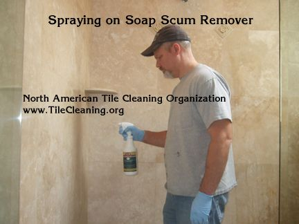 Spraying Travertine Shower With Soap Scum Remover Travertine