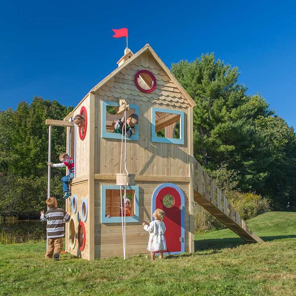 2 story outdoor playhouse with ramp big windows and bucket