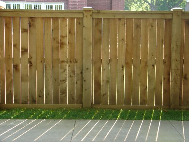 Wood Fence With Small Spaces Between Boards, Hefty Posts