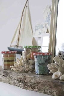 LAKE COTTAGE DREAMS: Beach House Decorating Ideas.  Display shells and sand in jelly jars.  I really like the touch of color from the cute gingham lids.