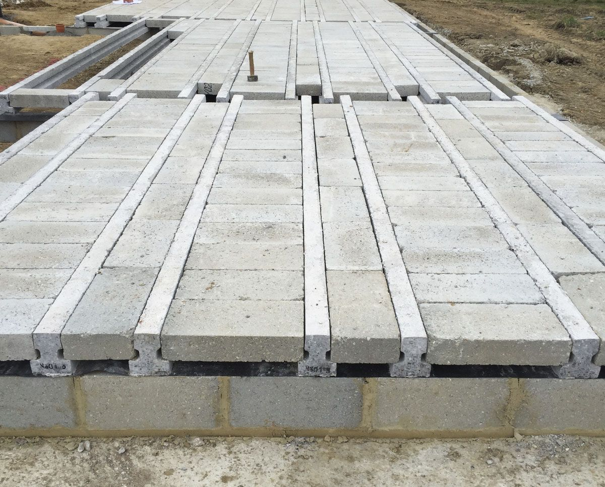 Beam block ground floor slab projects under for Concrete block floor