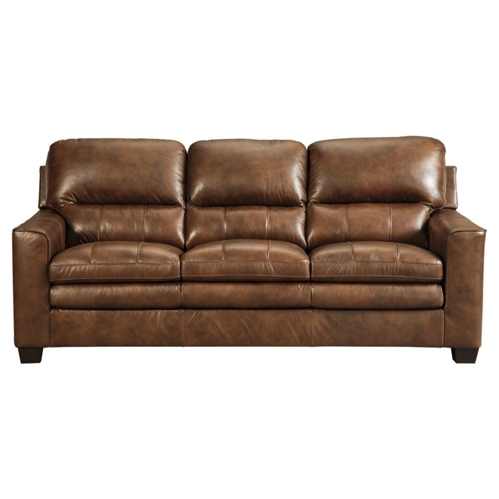 Theres Nothing Bland About This Sofa Two Tone Amber Brown Color Is Accented With Contras Contemporary Leather Sofa Signature Design Signature Design By Ashley