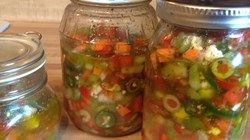 A hot and tangy, pickled pepper and jalapeno topping for Italian beef sandwiches, sausages, French dips, pastas, pizzas, and more.