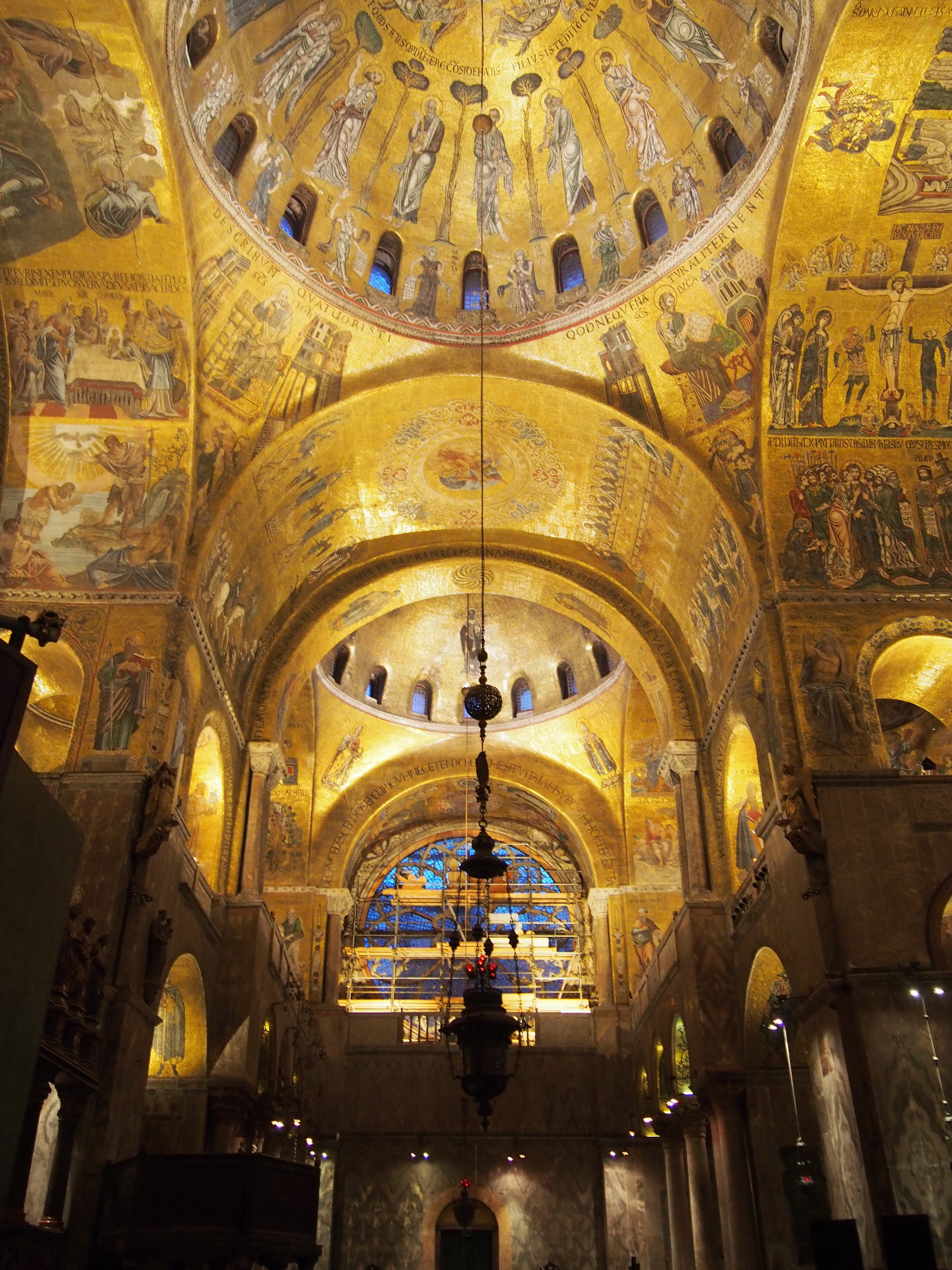 The interior of the domes in S Marco's basilica, Venice. Lights at ...