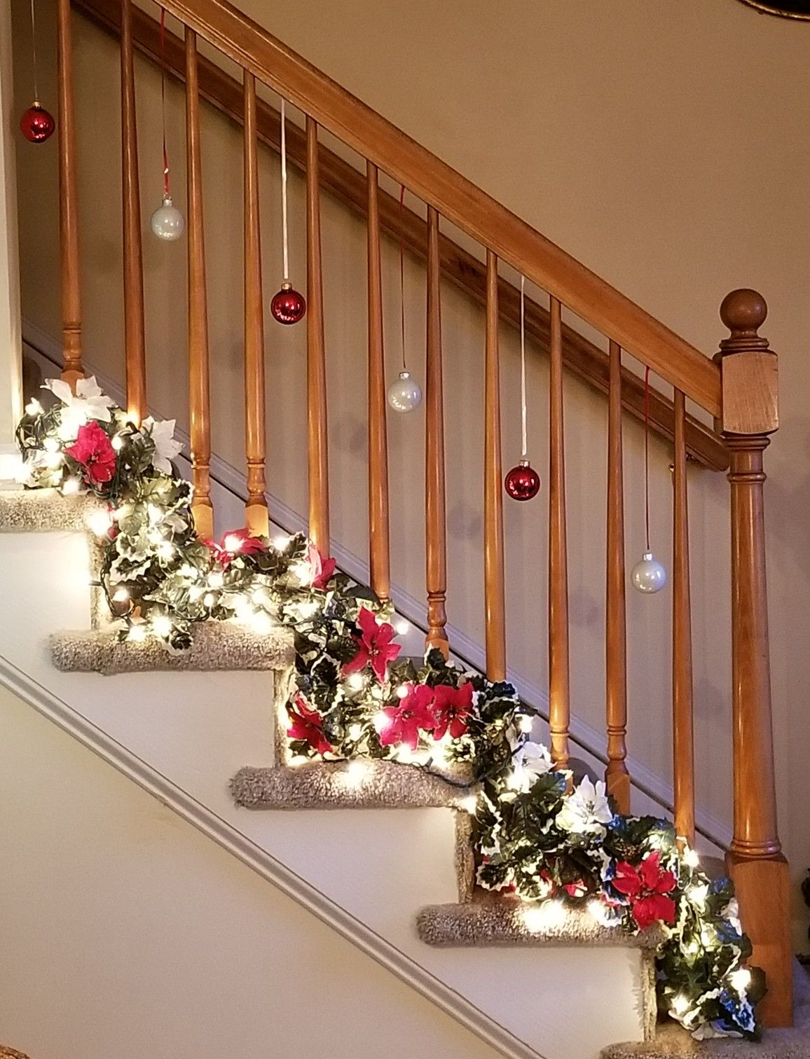 Holiday decor for a small stair rail red and white - Christmas decorations for stair rail ...