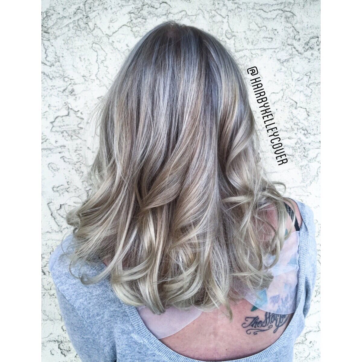 Cool blonde using Redken Shades EQ gloss in 09P and Kenra