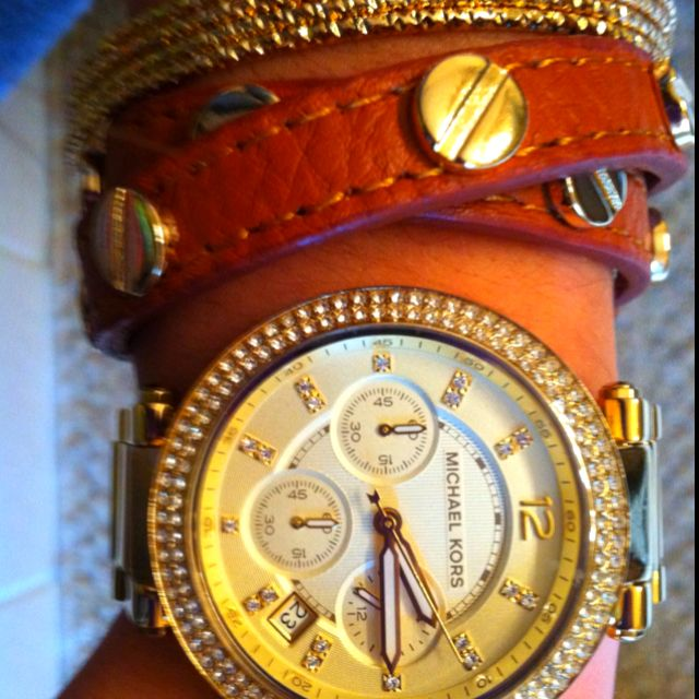Michael Kors watch with accent bracelets, classy!