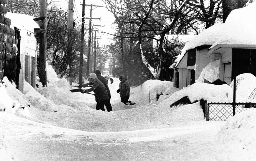 Blizzard of 1979 people shovel in an alley at harvey