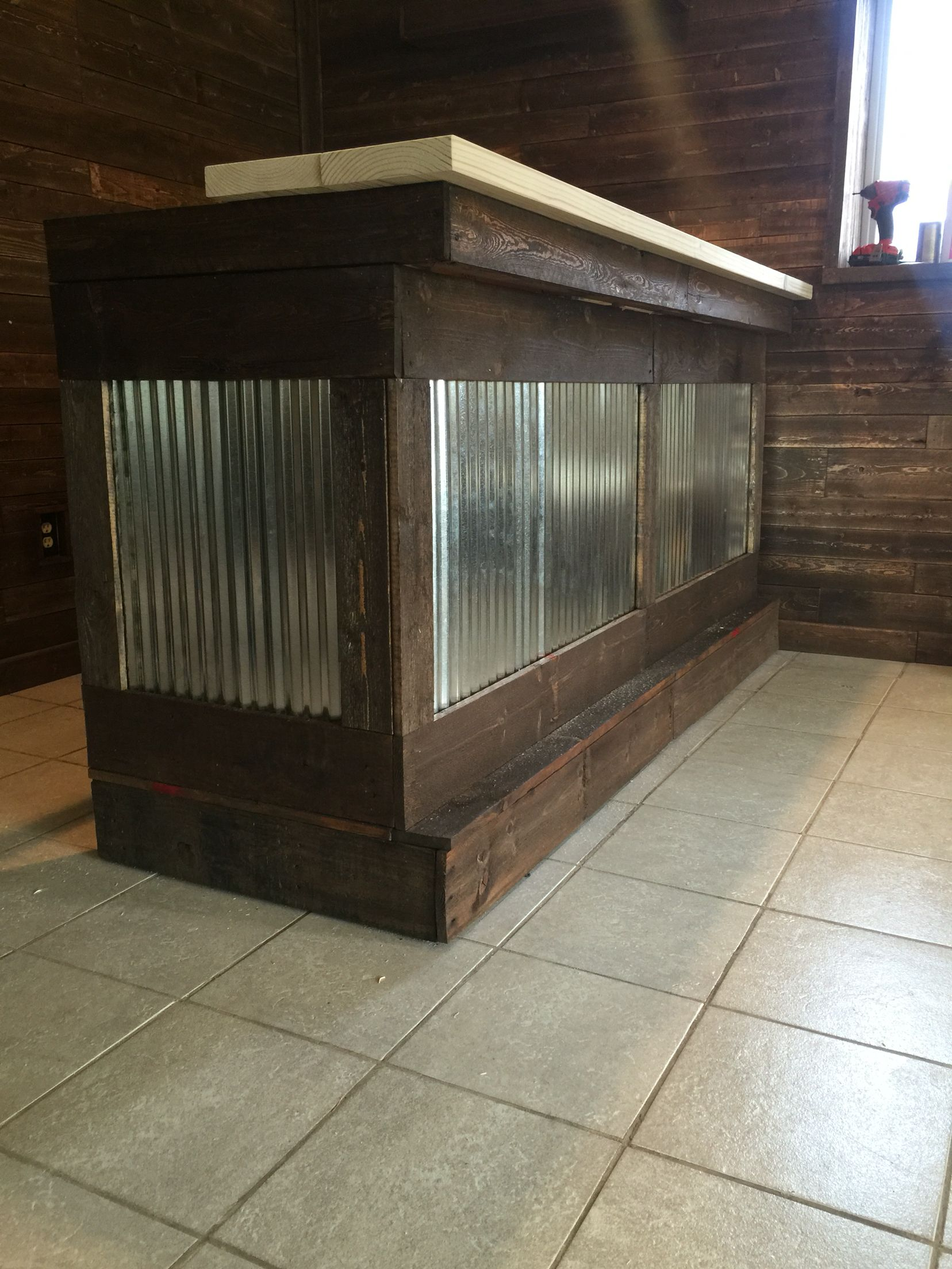 Pallet Bar With Galvanized Metal. Putting The Bar Top On.