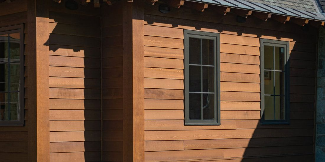 This Is A 1x10 Channel Rustic Cedar Siding This Is Also Unique By The Hand Hewn Finish On The Cedar They Have Also Used A Chinking Cedar Siding Siding Cedar