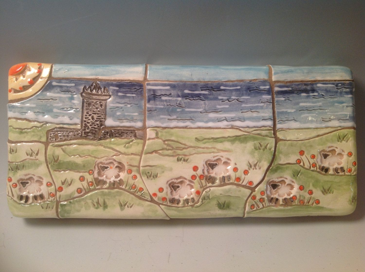 decorative tile/irish pottery/celtic pottery/sheep/irish seashore