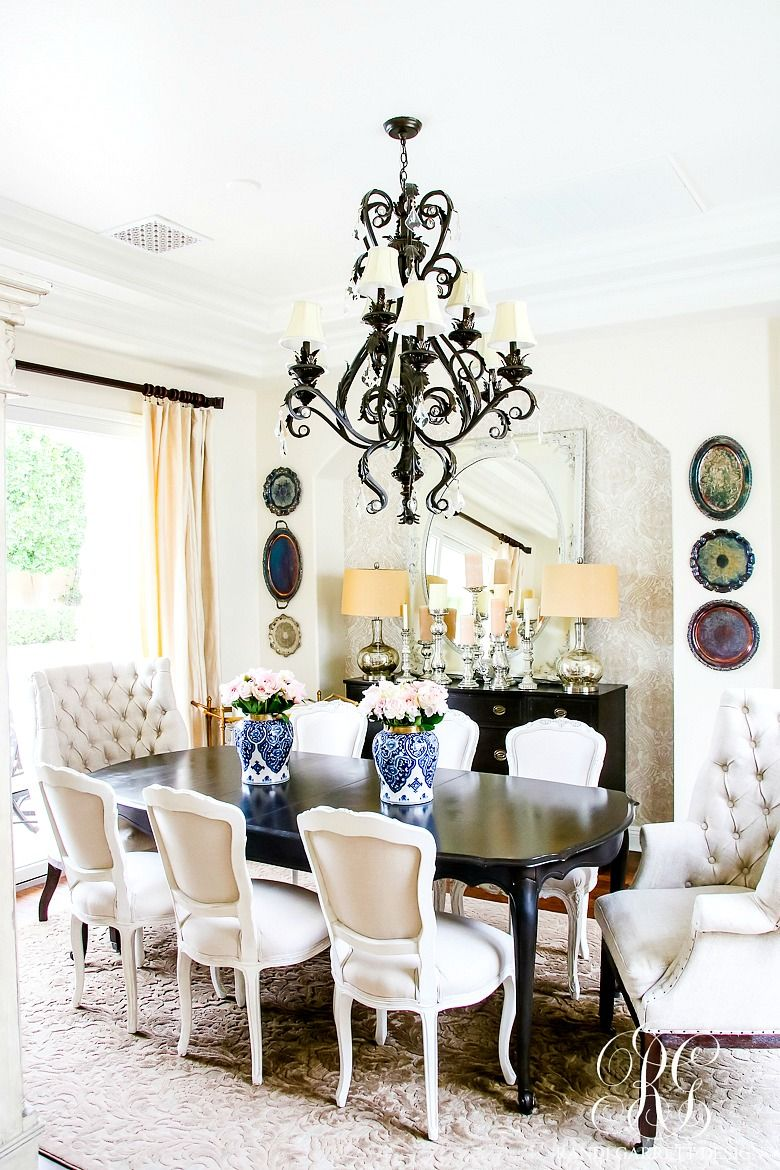 wrought iron chandelier with lampshades in dining room. soothing