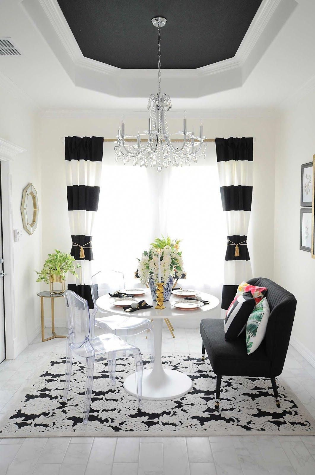 black and white striped curtains frame a small dining room space rh pinterest com