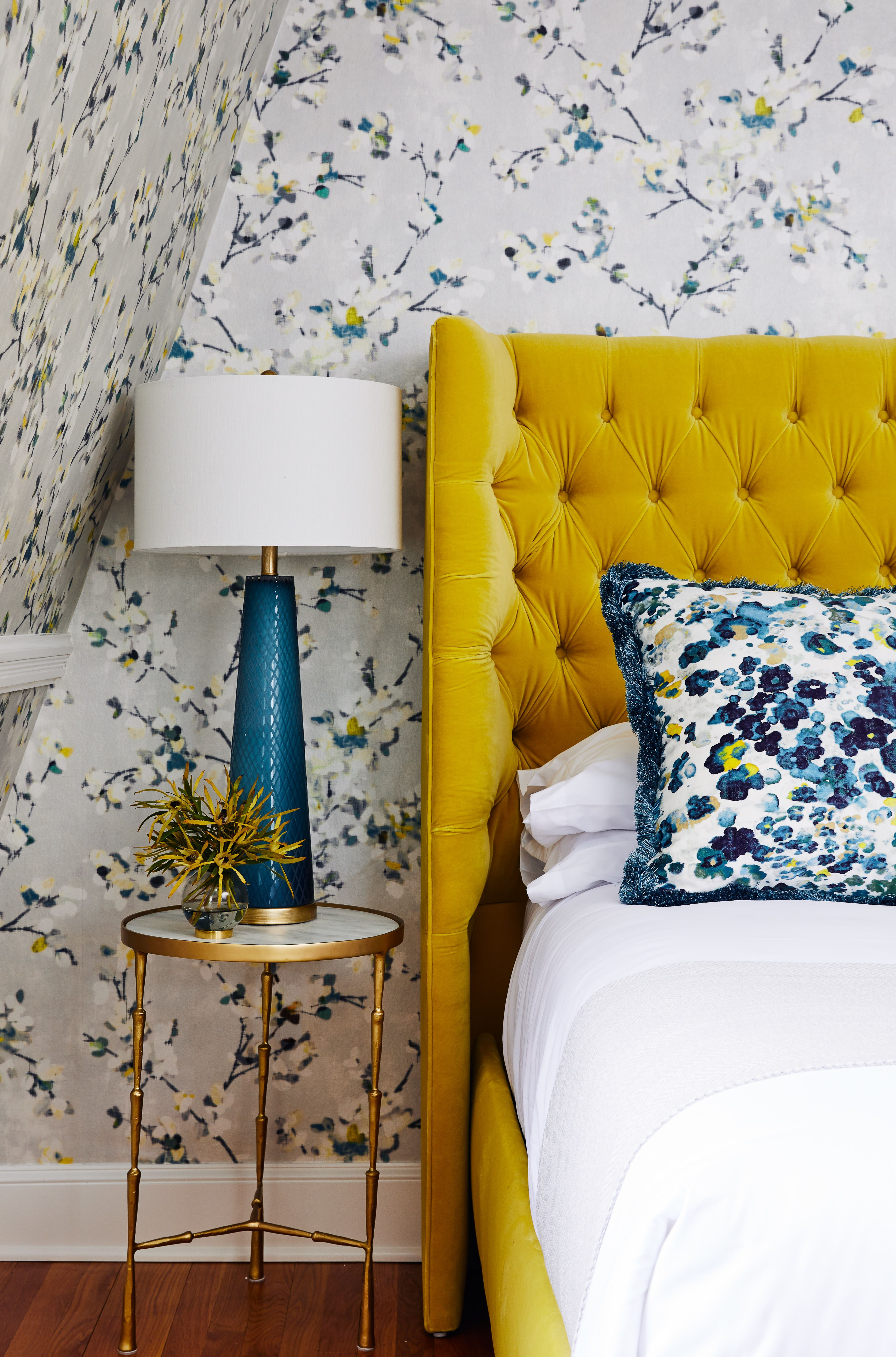 modern floral wallpaper by romo backs a bright yellow