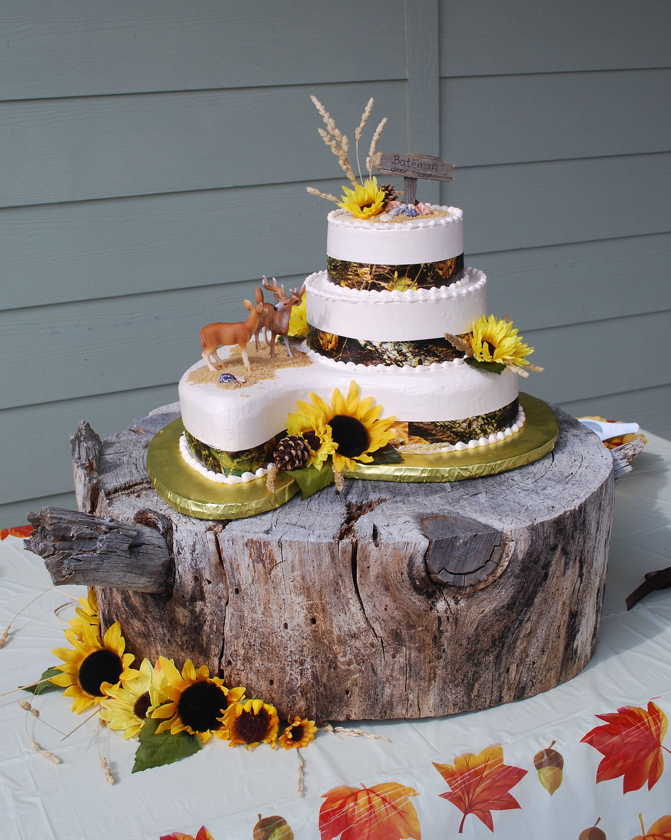 Camo wedding cake with the most awesome rustic wood slab