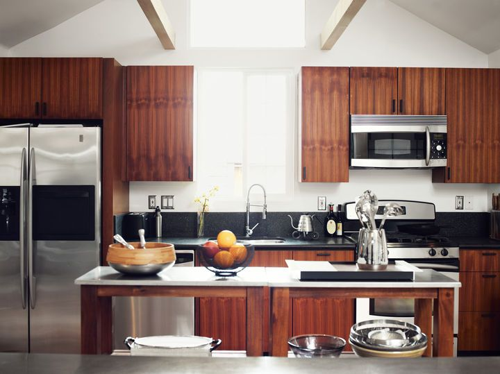 He worked with Kartheiser's existing appliances in the kitchen, trading the old cabinetry for new teak.