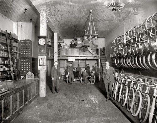 Antique Bike shop w/staff.