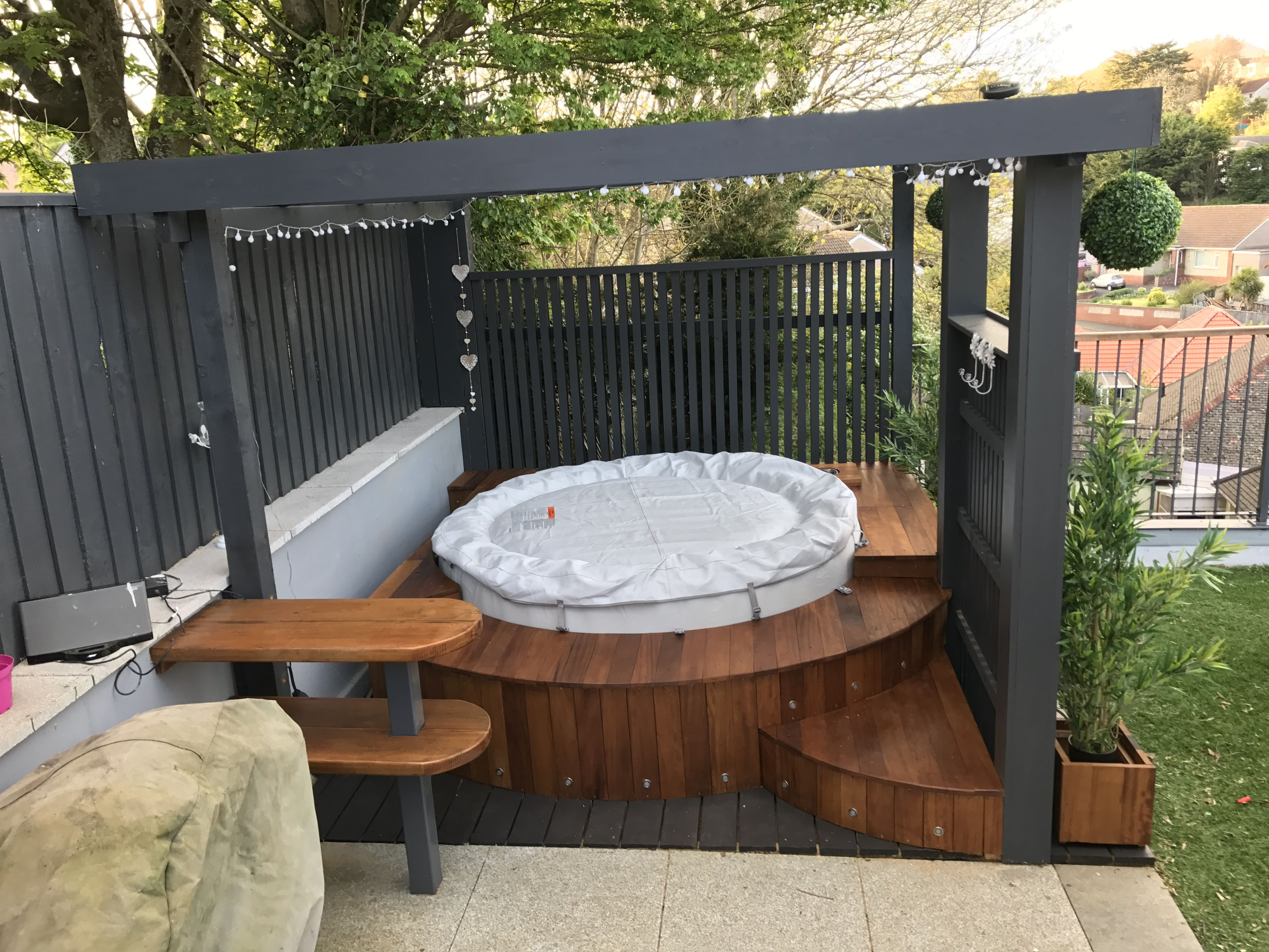 Modern pergola with lazy spa hot tub and insulated iroko for Spa pool garden ideas